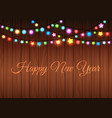 glowing garland on wood background vector image vector image