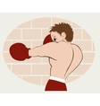 Young boxer in red shorts trained against a brick vector image vector image