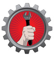 metal badge with hand with spanner vector image vector image