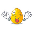tongue out golden egg with cartoon shape vector image