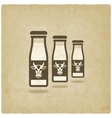 milk bottles with cow label vector image vector image