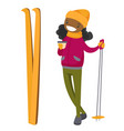 young african woman drinking coffee at ski resort vector image vector image