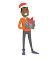 young african-american man holding christmas gift vector image vector image