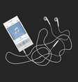 phone with earphones lying on a table vector image