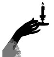 female hand holding a candle vector image vector image