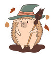 hedgehog in a witches hat with a broom isolate vector image