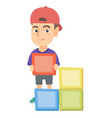 little caucasian boy playing with clourful cubes vector image vector image
