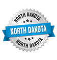 North Dakota round silver badge with blue ribbon vector image vector image