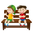 two boys sitting on wooden chair vector image vector image