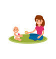 a babysitter or nanny sits on the carpet and plays vector image