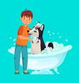 kid washing dog pet wash in bathtub vector image