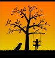 silhouette boy on the swing with his dog vector image