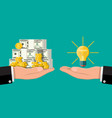 glass light bulb and money in hand vector image