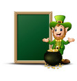 smiling leprechaun cartoon with chalkboard and pot vector image