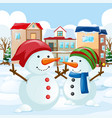 two snowman in the field vector image