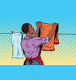 vintage employee hangs up to dry clothes vector image
