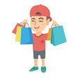 happy caucasian boy holding shopping bags vector image vector image