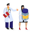 two smiling young doctors in white medical coats vector image