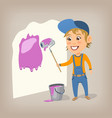 happy woman painter paints wall with a paint vector image