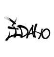 sprayed idaho font graffiti with overspray in vector image vector image