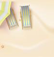 sun loungers under parasol on the sandy beach vector image vector image