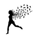 silhouette of young woman jumping with birds vector image vector image