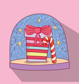 snowing glass ball with present and candy cane vector image