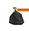 hand holding black plastic trash bag image vector image