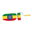 brush stroke with ethiopia national flag isolated vector image vector image