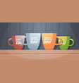 colorful cups on wooden table with text happy vector image