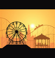 silhouettes of a city and amusement park vector image