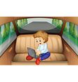 Little boy using computer in the car vector image