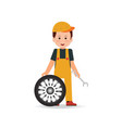 tire service man worker changing tire vector image vector image