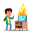 scared asian kid next to burst into flame laptop vector image vector image