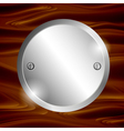 Metal circle-plate on wooden surface vector image