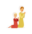 little girl with mother kneeling and praying to vector image vector image
