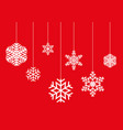hanging snowflakes on a red background vector image