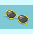 Yellow summer sunglasses isolated on blue