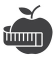 Apple with measuring tape glyph icon fitness