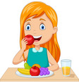 little girl eating fruits at table vector image vector image