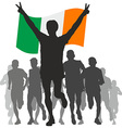 Winner with the Ireland flag at the finish vector image vector image