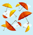 umbrellas fall on blue sky background flat design vector image vector image