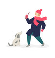a girl playing with a domestic dog on street vector image vector image