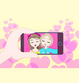 hand holding smart phone take selfie photo of two vector image vector image