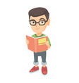 little caucasian schoolboy reading a book vector image