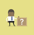 african businessman standing beside unknown box vector image