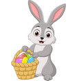 cartoon rabbit holding an easter basket vector image vector image