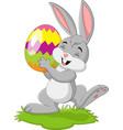 cartoon little rabbit holding easter egg in gr vector image vector image