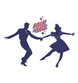 young couple wearing 50s clothes dancing rock