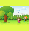 park scene with two kids catching butterflies vector image vector image